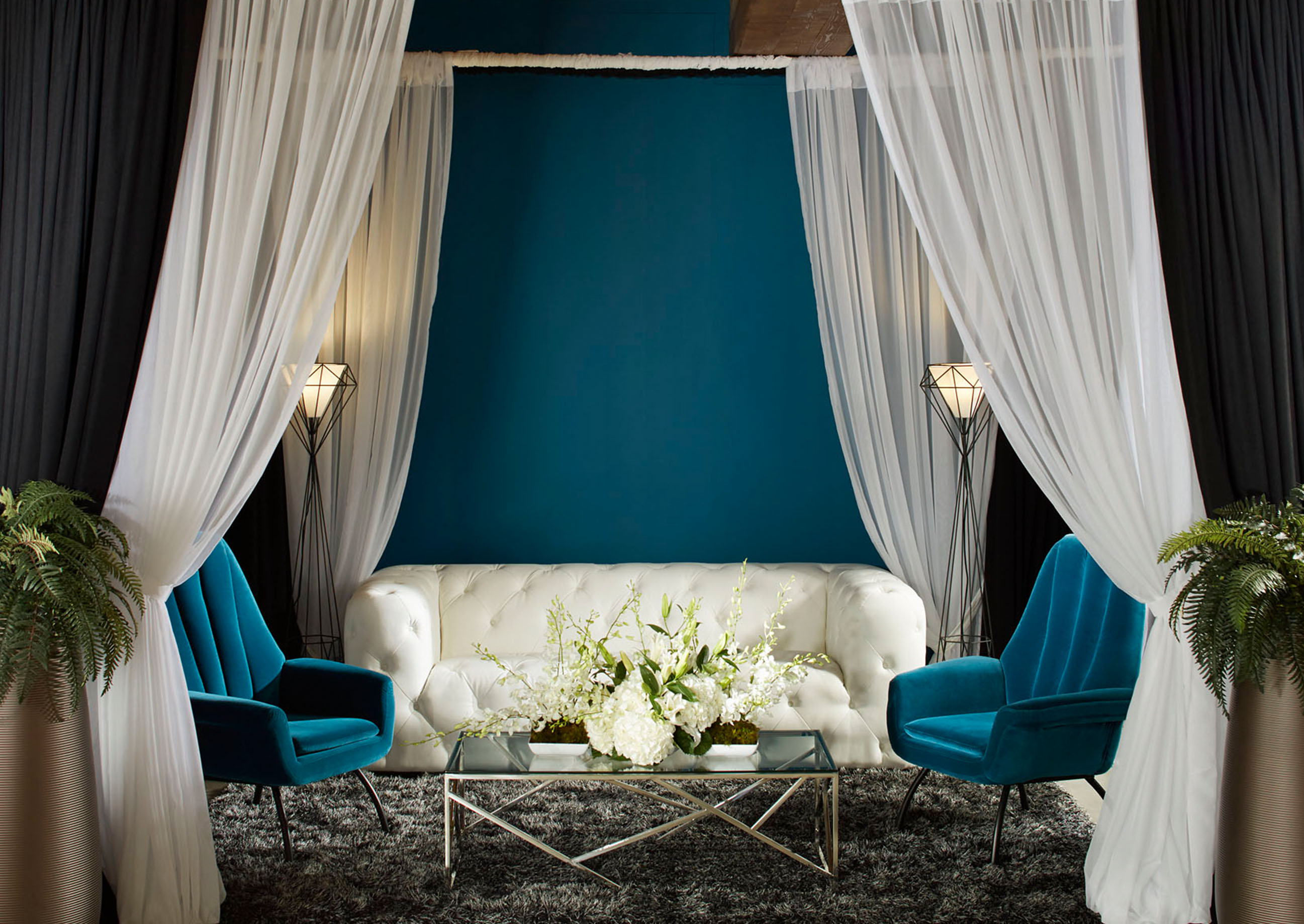 Event with white and teal furniture
