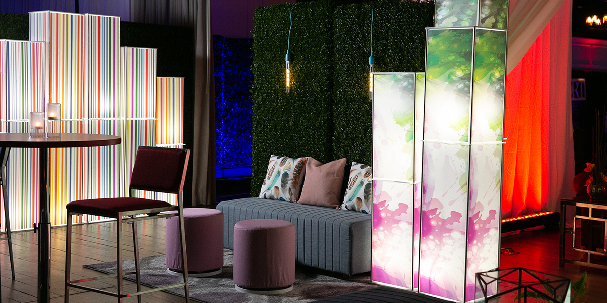 Lighted columns with custom graphics at party