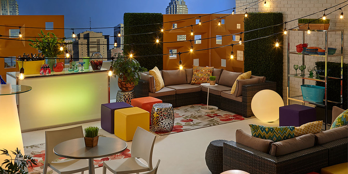Rooftop event with beige outdoor soft seating